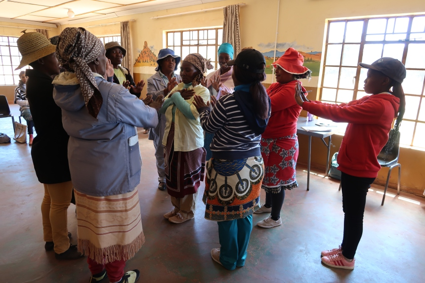 women stand in a circle ready to conduct a trust exercise in the Malealea Development Trust's HIV/AIDs support group, Lesotho, Southern Africa