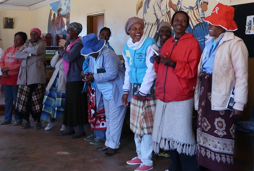 women in the Malealea Development Trust's HIV/AIDs support group laugh at something that was brought up during a discussion in Lesotho, Southern Africa