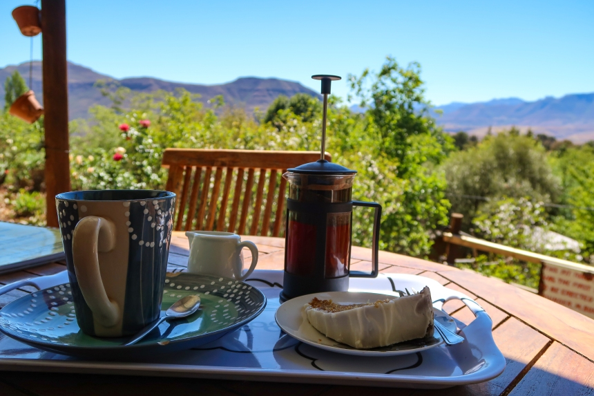 a tray of French Press coffee and carrot cake with a view of the Maloti Mountains at the Malealea Lodge Coffee Shop in Malealea, Lesotho, Southern Africa, photo by Kelly Benning