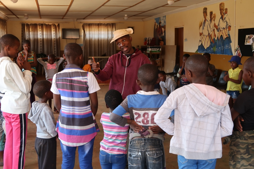 MDT Field Worker Tsotang Monyane addresses a group of kids, explaining how to do an exercise in Lesotho, Southern Africa