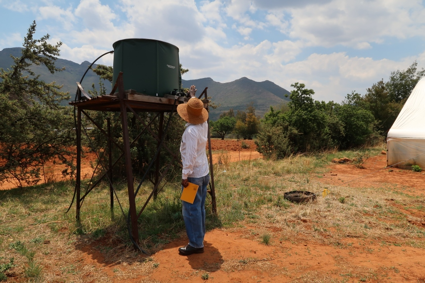 Albert Musi, a farmer, checks the pressure of one of his water tanks that irrigates his fields, in front of the Maloti Mountains of Malealea, Lesotho, Southern Africa