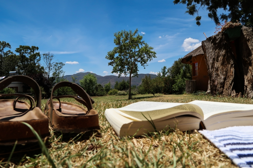 Books and Sun on the Malealea Lodge Grounds, photo by Kelly Benning