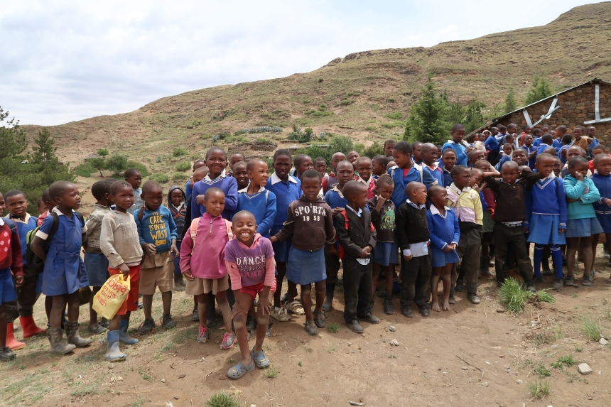 a group of children gather for photos outside their rural school in mountainous Malealea, Lesotho