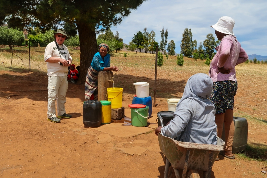 women gather at Ha Raboletsi's communal tap, Roma, Lesotho, Southern Africa, photo by Kelly Benning